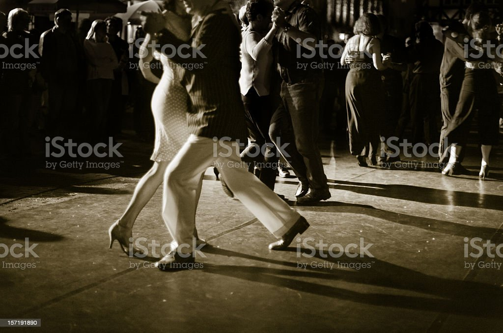 Couple dancing Argentine Tango outdoors at night. stock photo