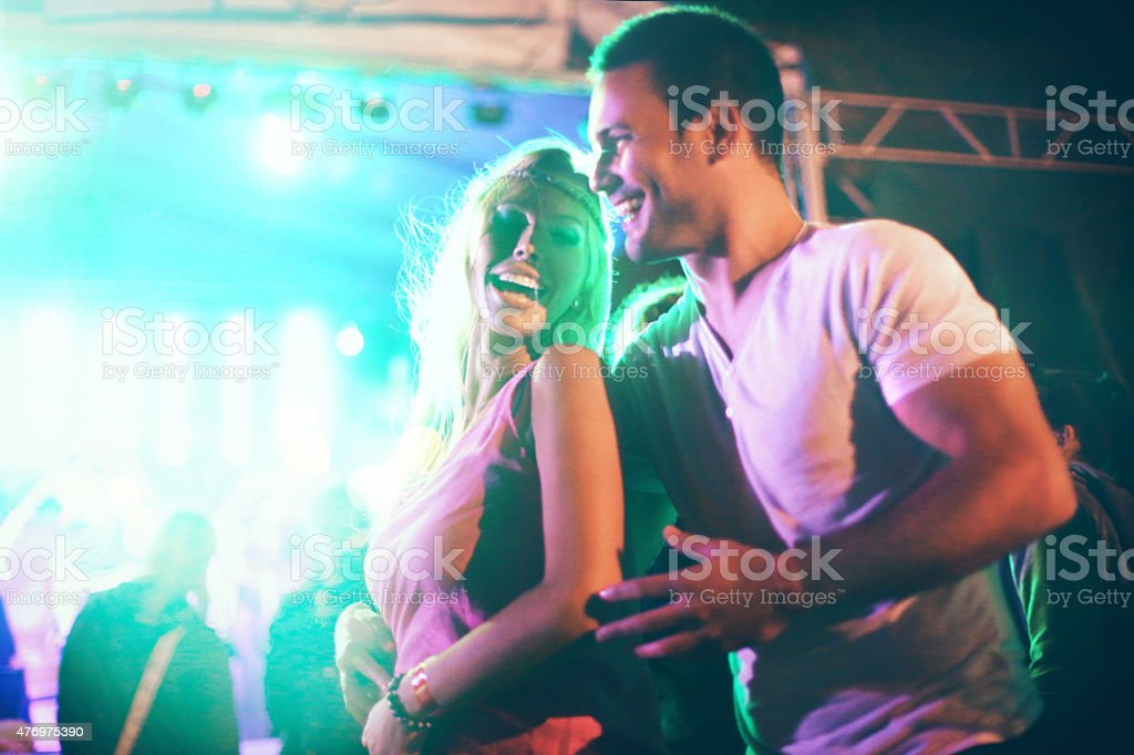 Couple dancing at concert party. stock photo