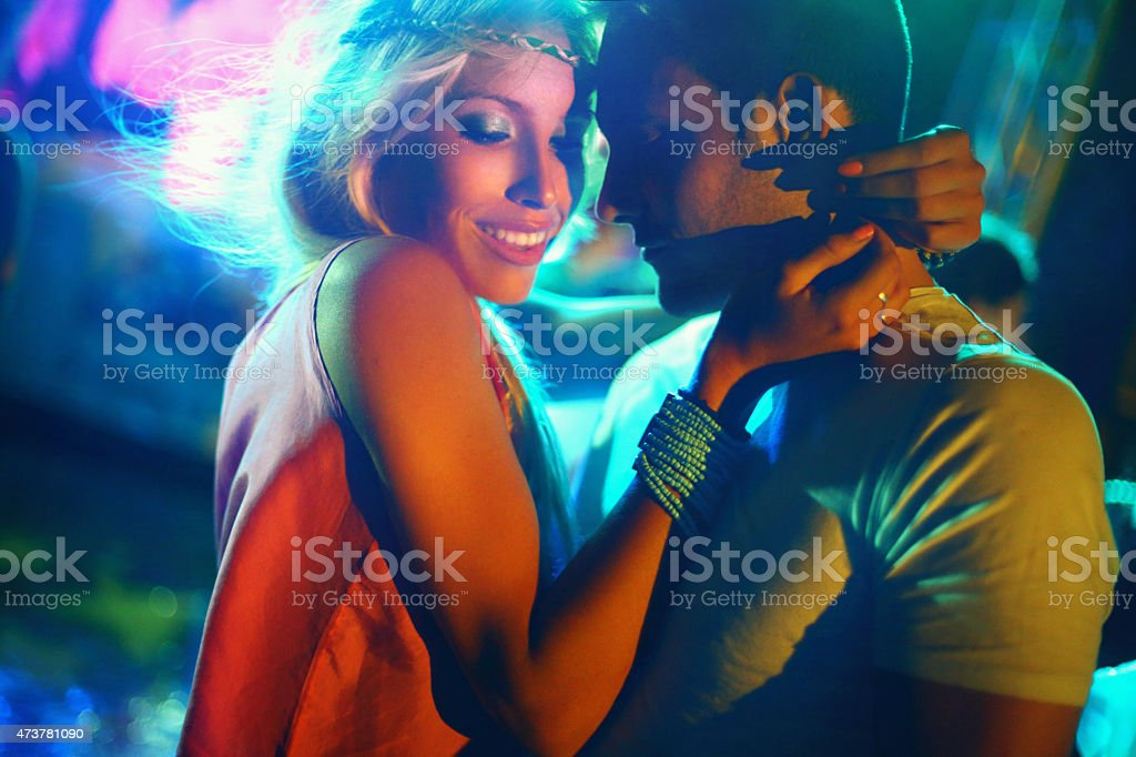 Couple dancing at concert. stock photo