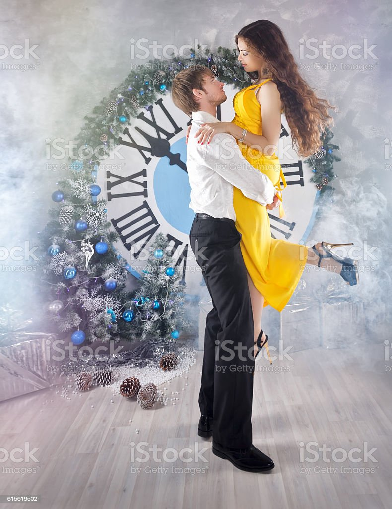 Couple dancing. Christmas party. stock photo