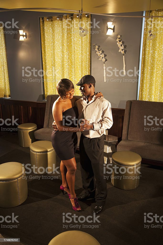 Couple dancing in bar lounge royalty-free stock photo