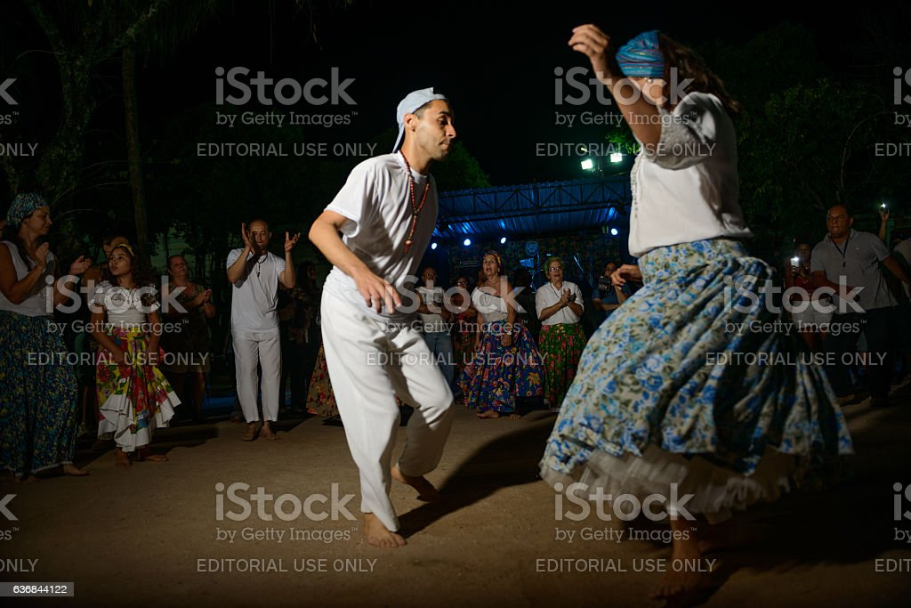 Couple dancing Jongo during performance at square stock photo