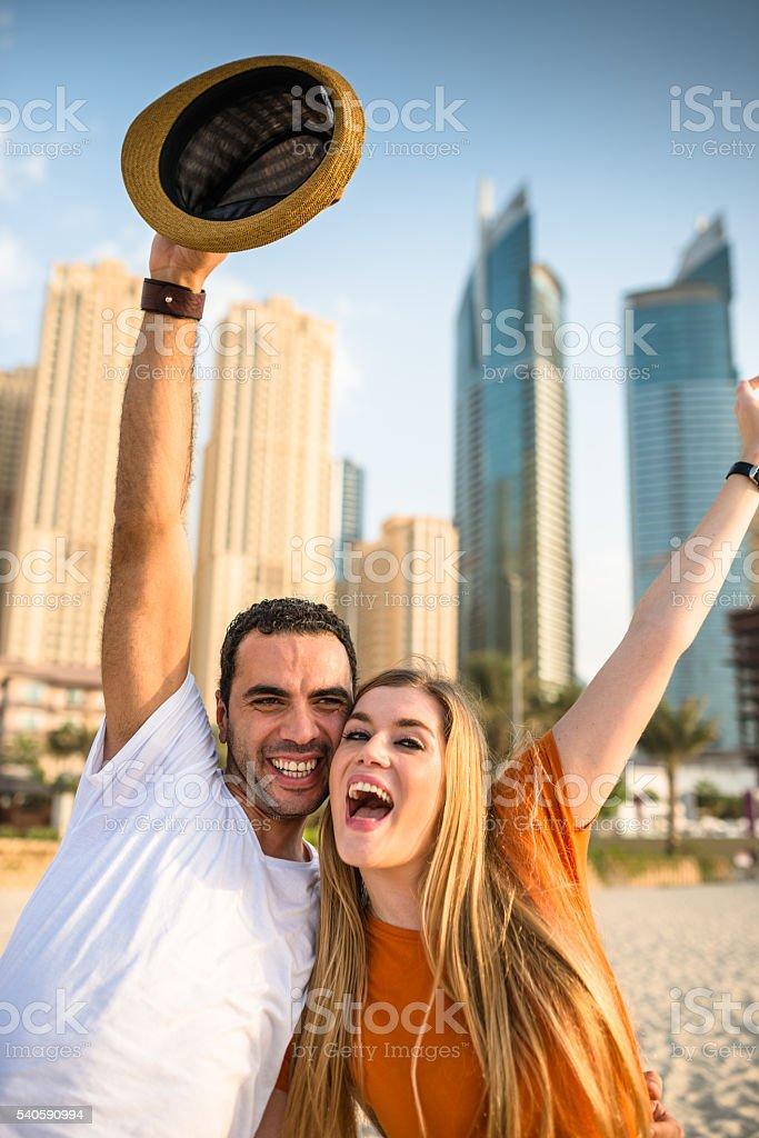 couple dancing on a beach party in dubai marina beach stock photo
