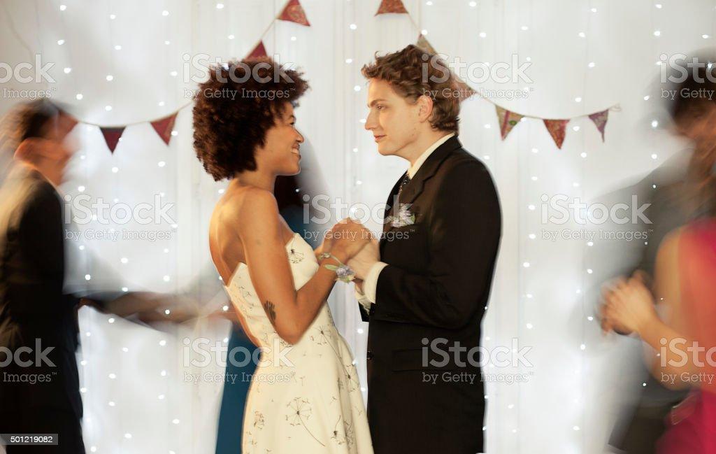 Couple dancing on dance floor stock photo