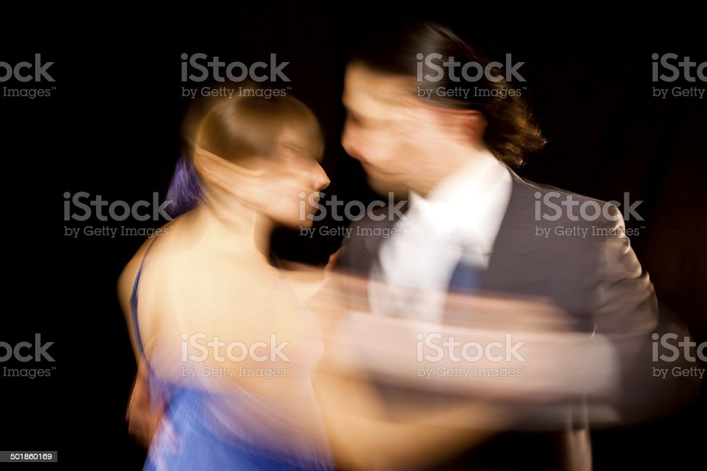 Couple dancing tango in Buenos Aires blurred motion stock photo