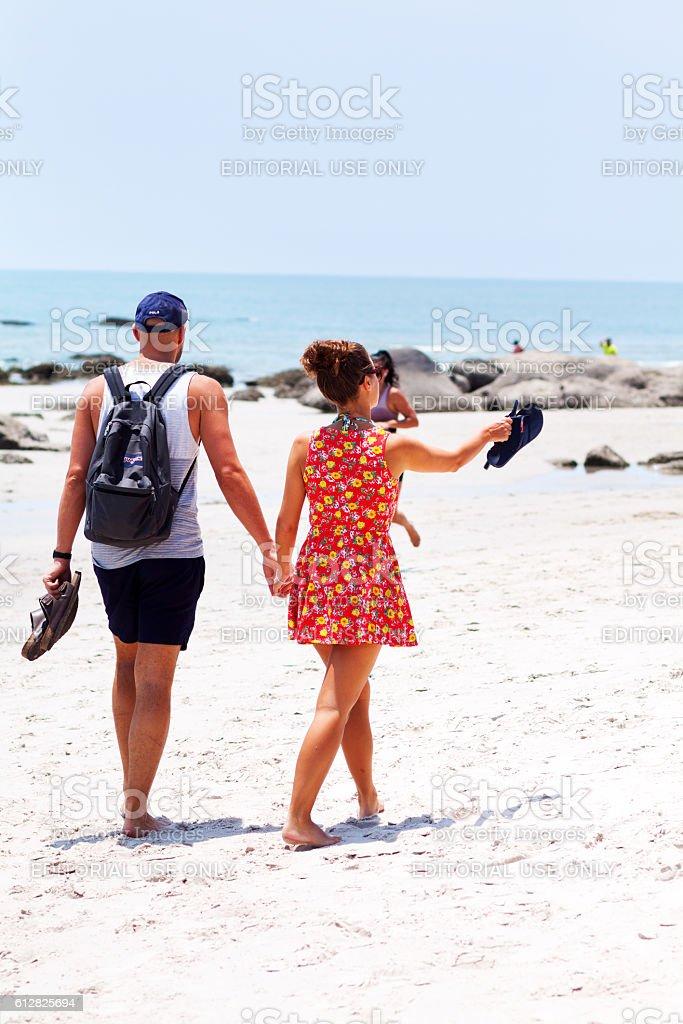 Couple dandering on beach in Hua Hin stock photo
