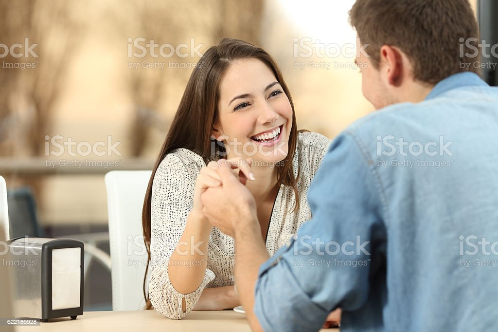 Couple dating and flirting in a coffee shop stock photo