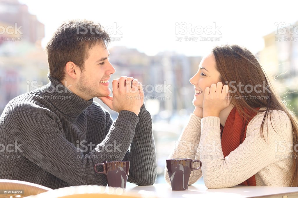 Couple dating and flirting looking each other stock photo