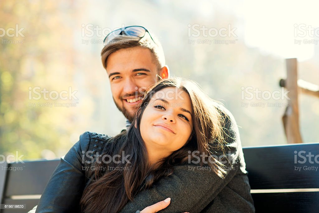 Couple dating and hugging stock photo