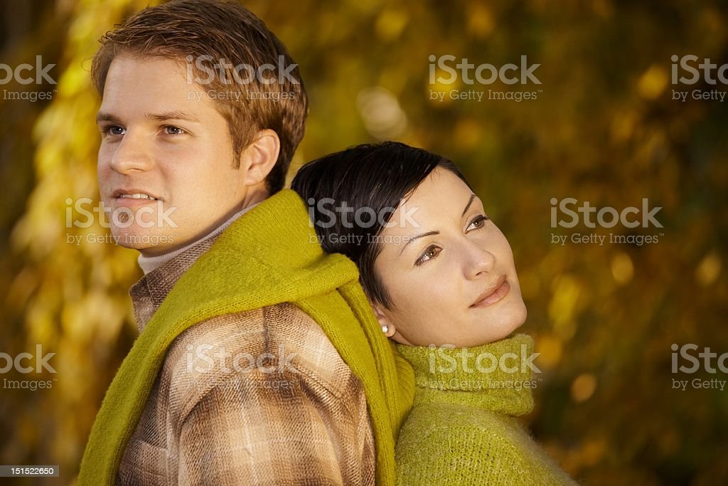 Couple daydreaming in park stock photo