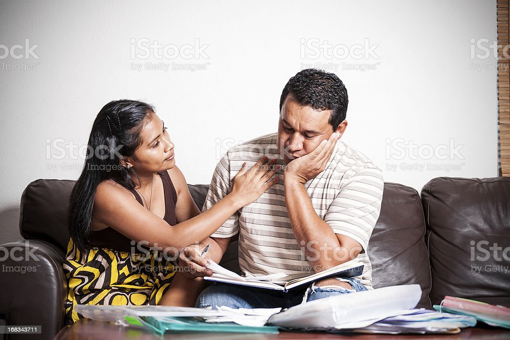 Couple dealing with financial or legal difficulties stock photo
