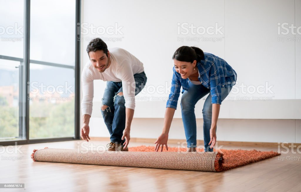 Couple decorating their new house stock photo