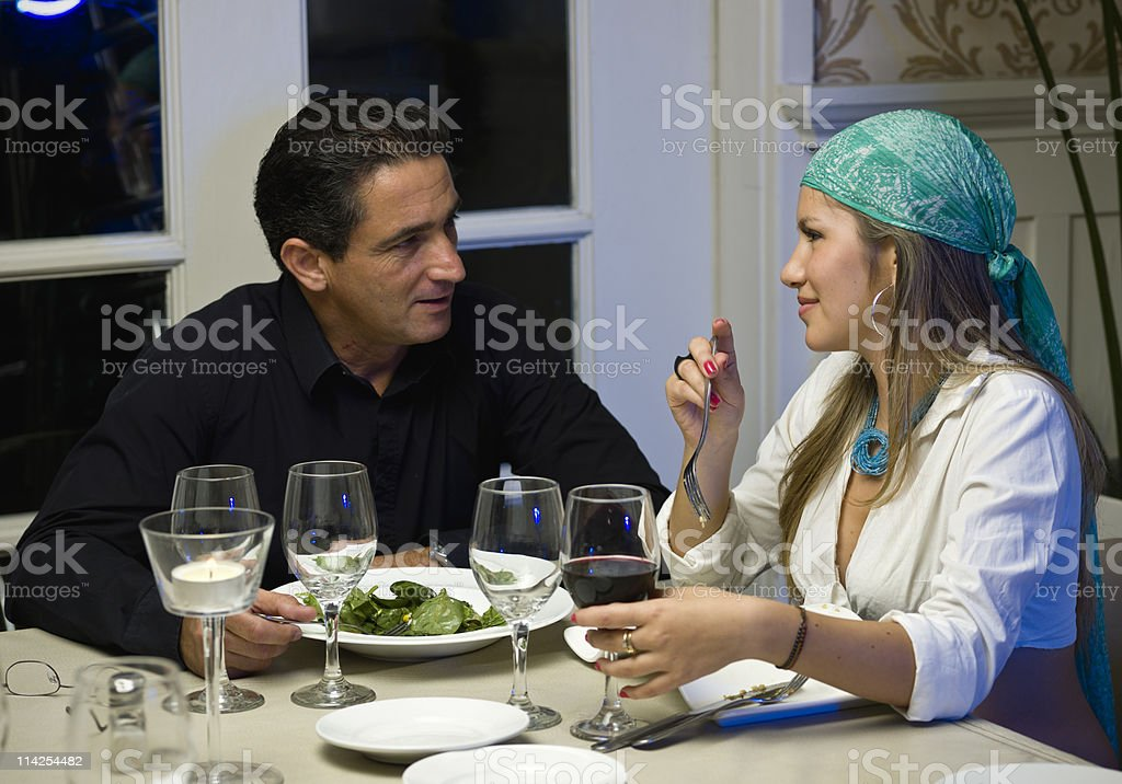 Couple Dining at a Restaurant stock photo