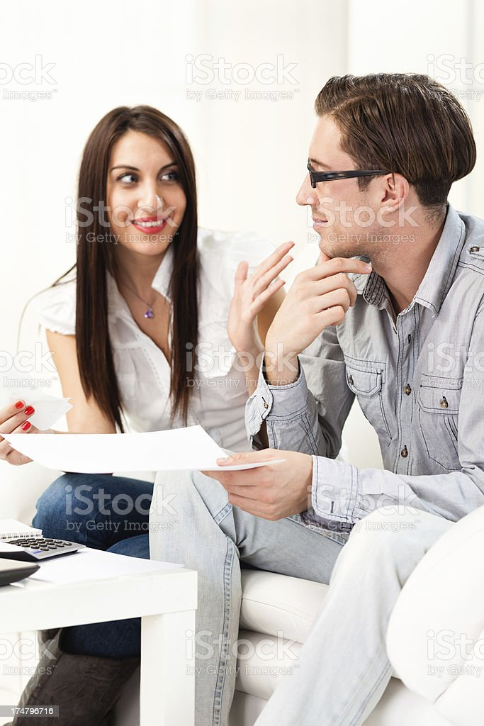 Couple discussing about home finances royalty-free stock photo