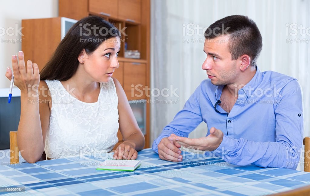 Couple discussing details of separation stock photo