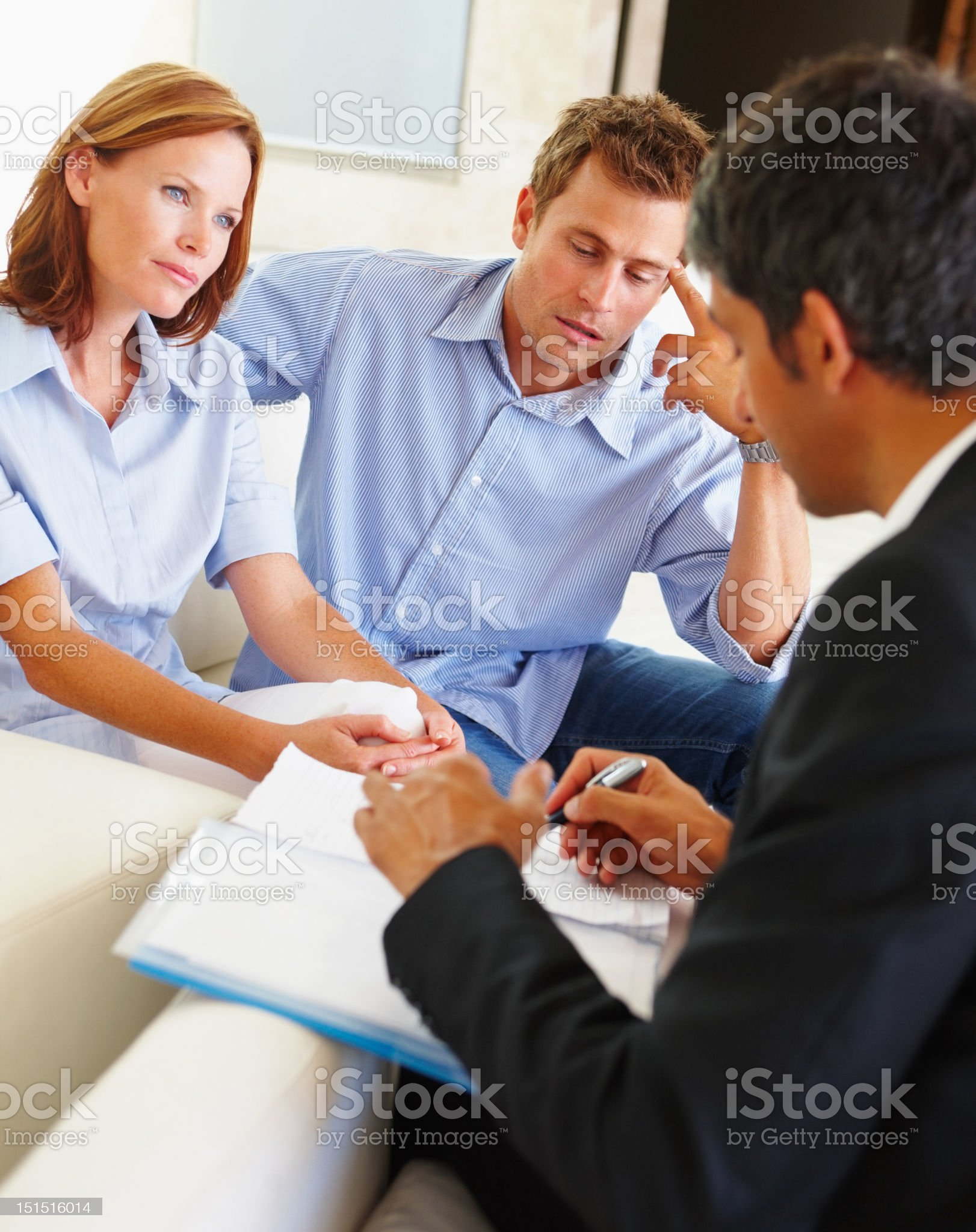 Couple discussing financial matter with bank executive royalty-free stock photo