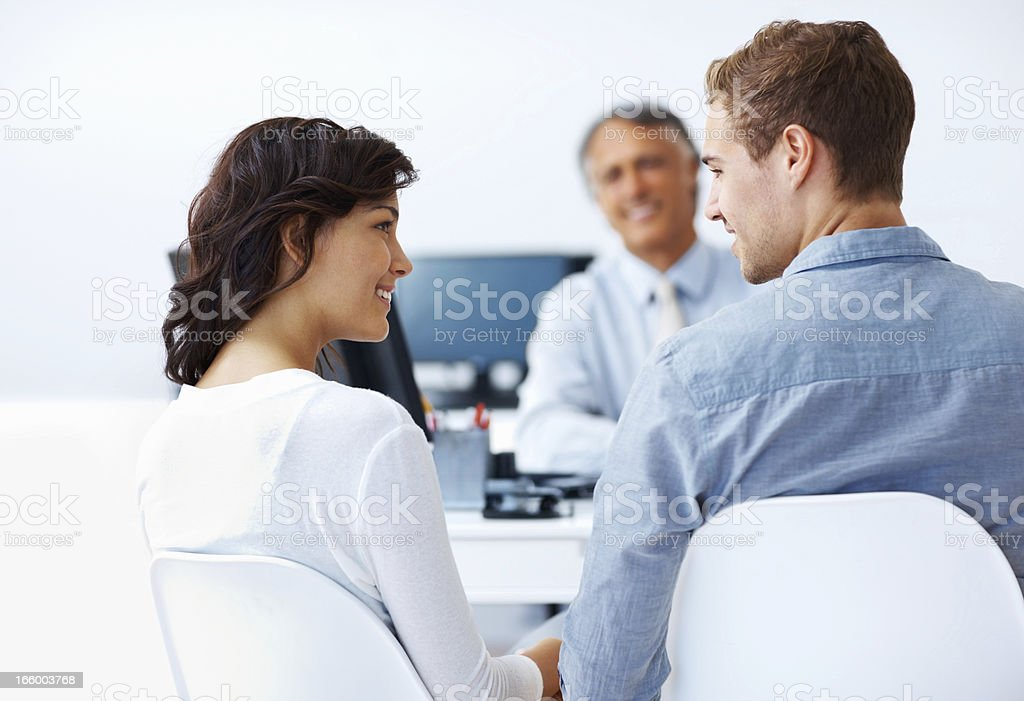 Couple discussing financial plans with advisor royalty-free stock photo