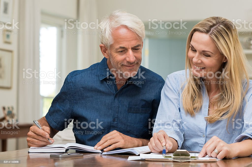 Couple discussing home economics stock photo