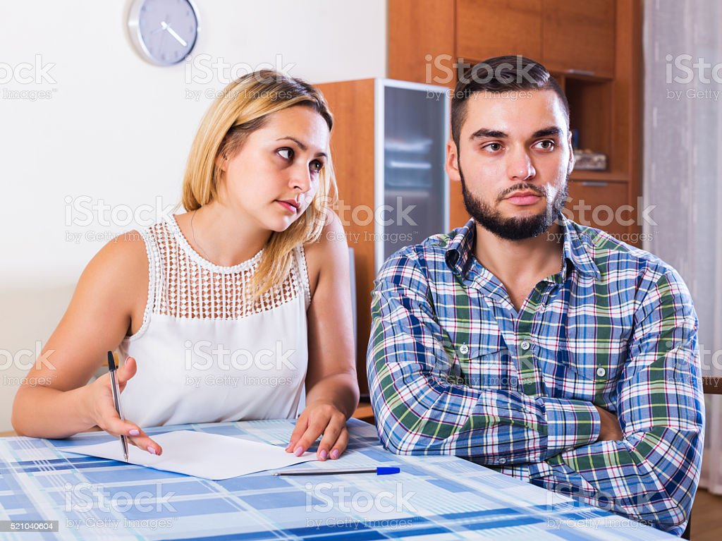 Couple discussing serious financial situation stock photo