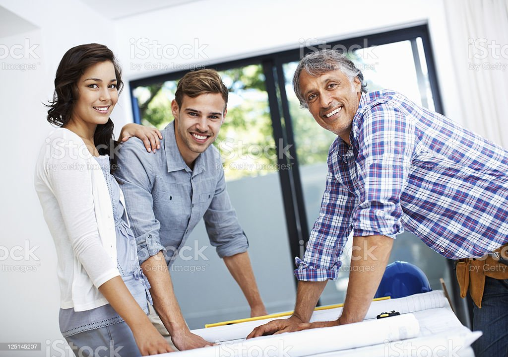 Couple discussing with contractor in office royalty-free stock photo