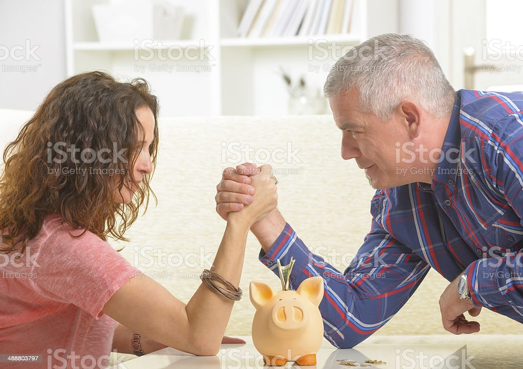 Couple doing armwrestling stock photo