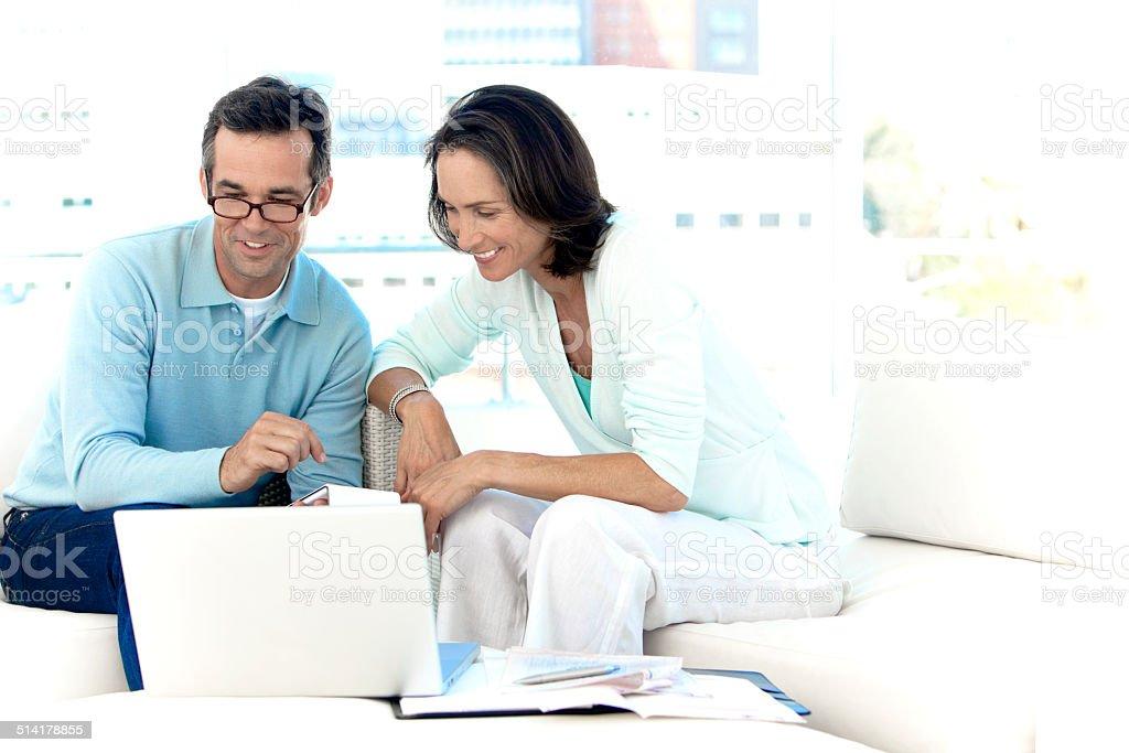 Couple doing Home Finances stock photo