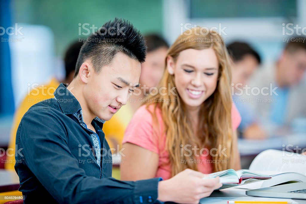 Couple Doing Homework Together stock photo