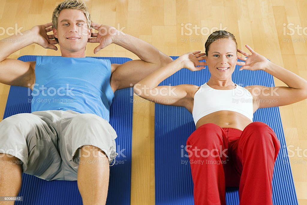 Couple doing Sit-ups royalty-free stock photo