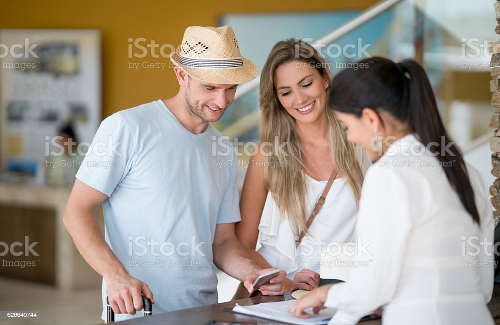 Couple doing the check-in at the hotel stock photo