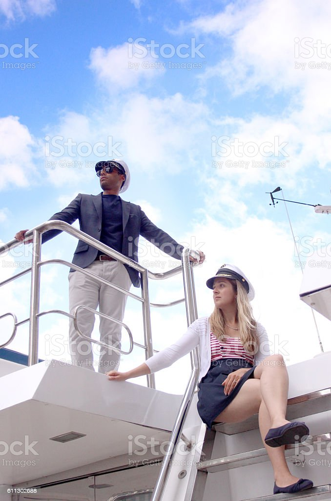 Couple dressed up on a boat stock photo