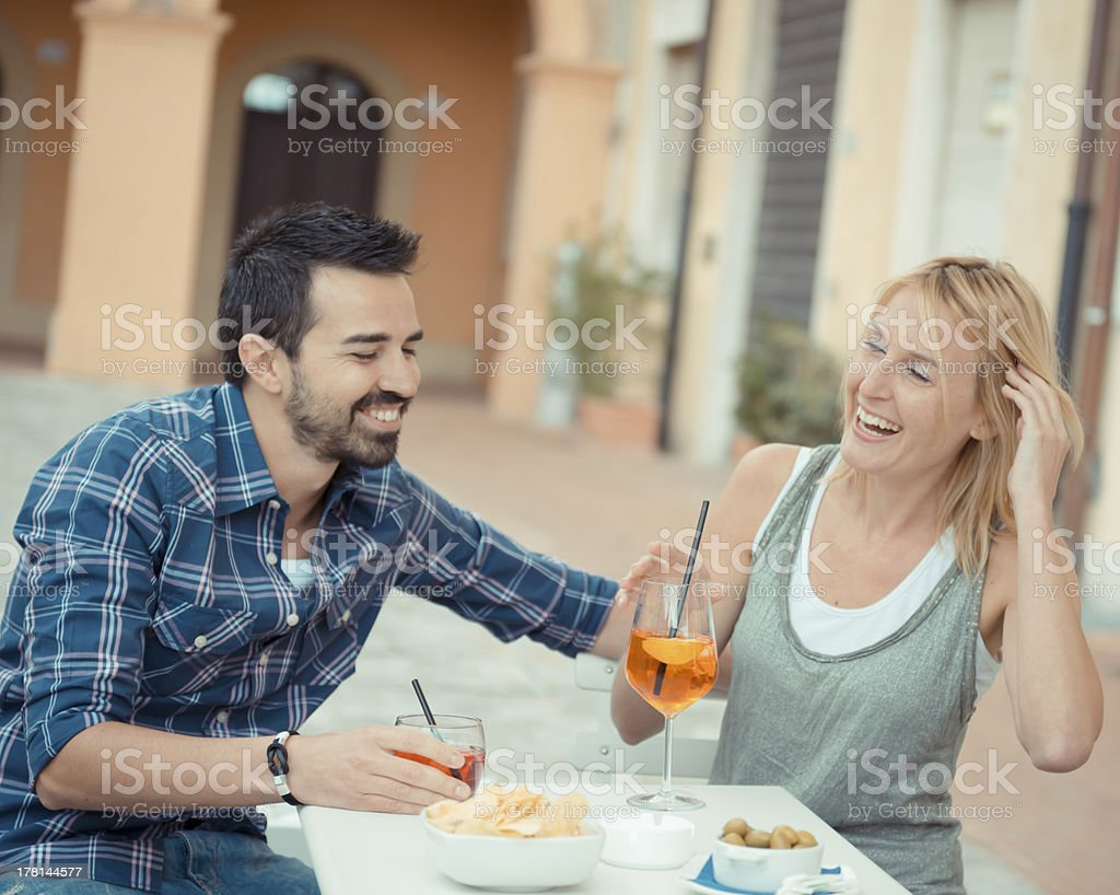 Couple drinking aperitif in a Bar stock photo