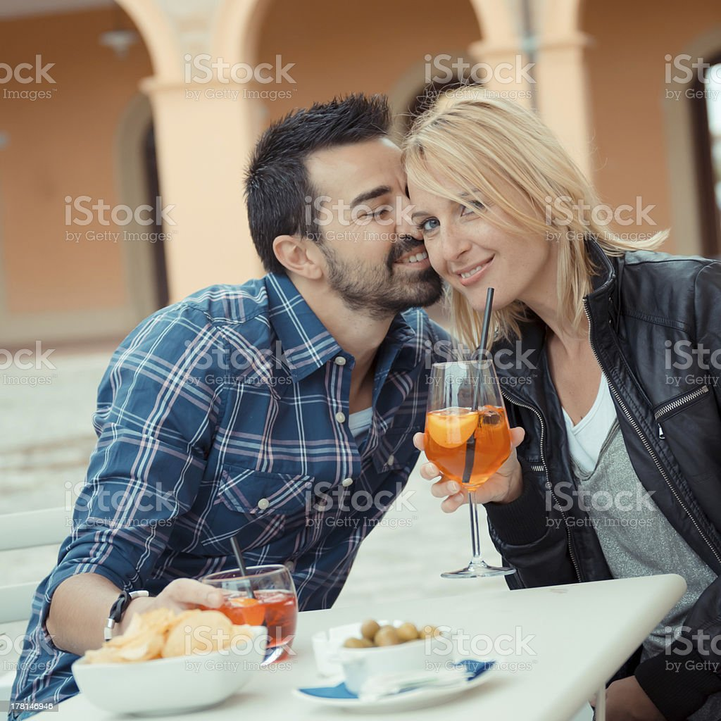 Couple drinking aperitif in a Bar royalty-free stock photo