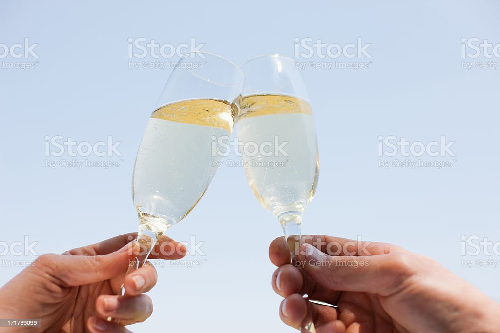 Couple drinking Champagne and toasting stock photo