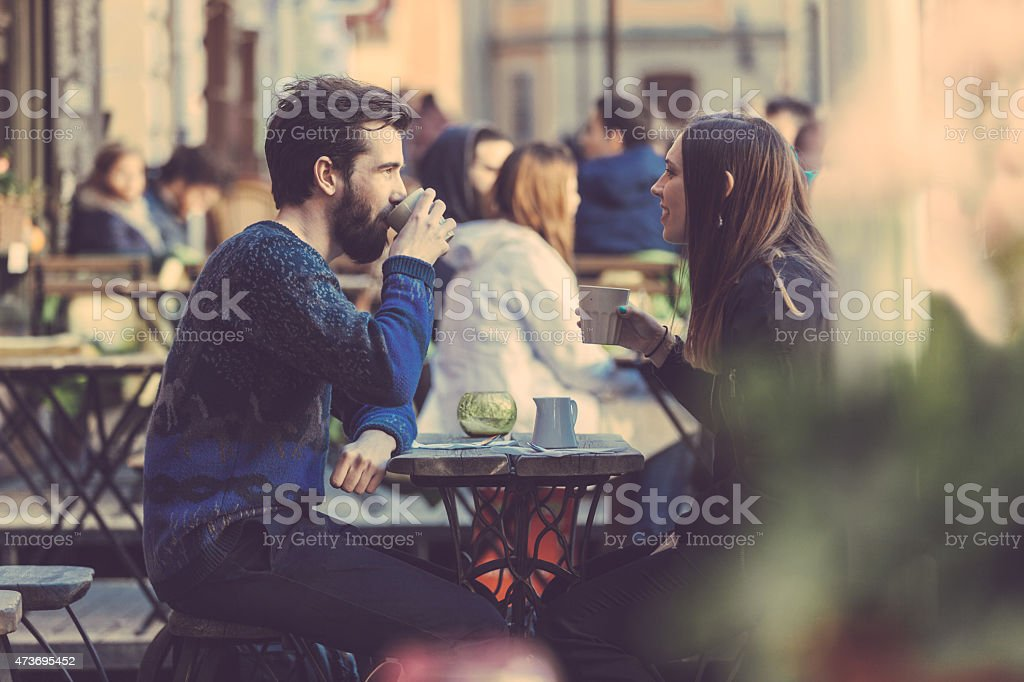 A couple drinking coffee at a picnic table in Stockholm stock photo
