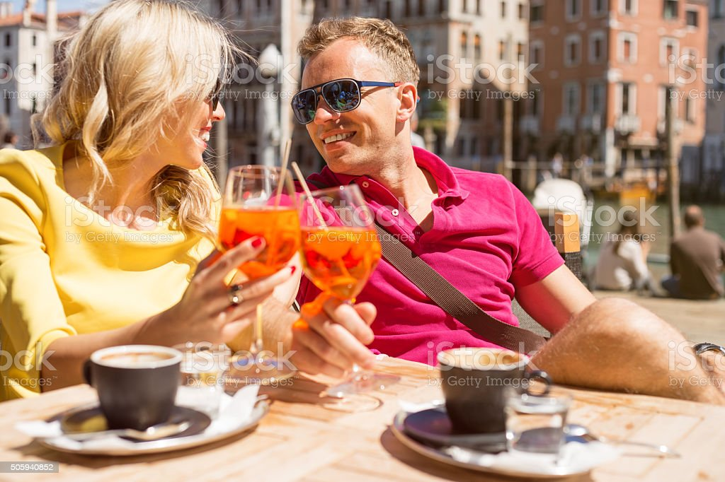 Couple drinking Aperol Spritz cocktail in cafe stock photo
