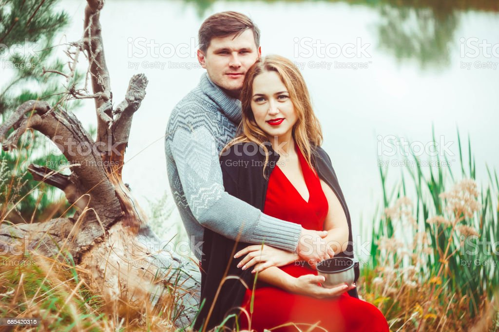 Couple drinking tea in the forest stock photo