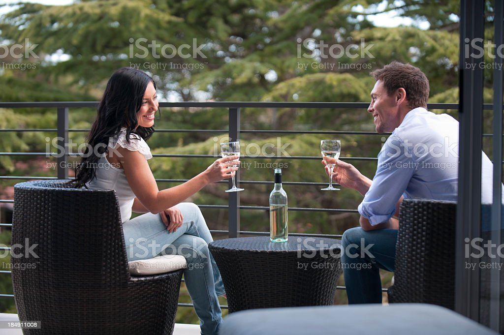 Couple drinking wine smiling royalty-free stock photo