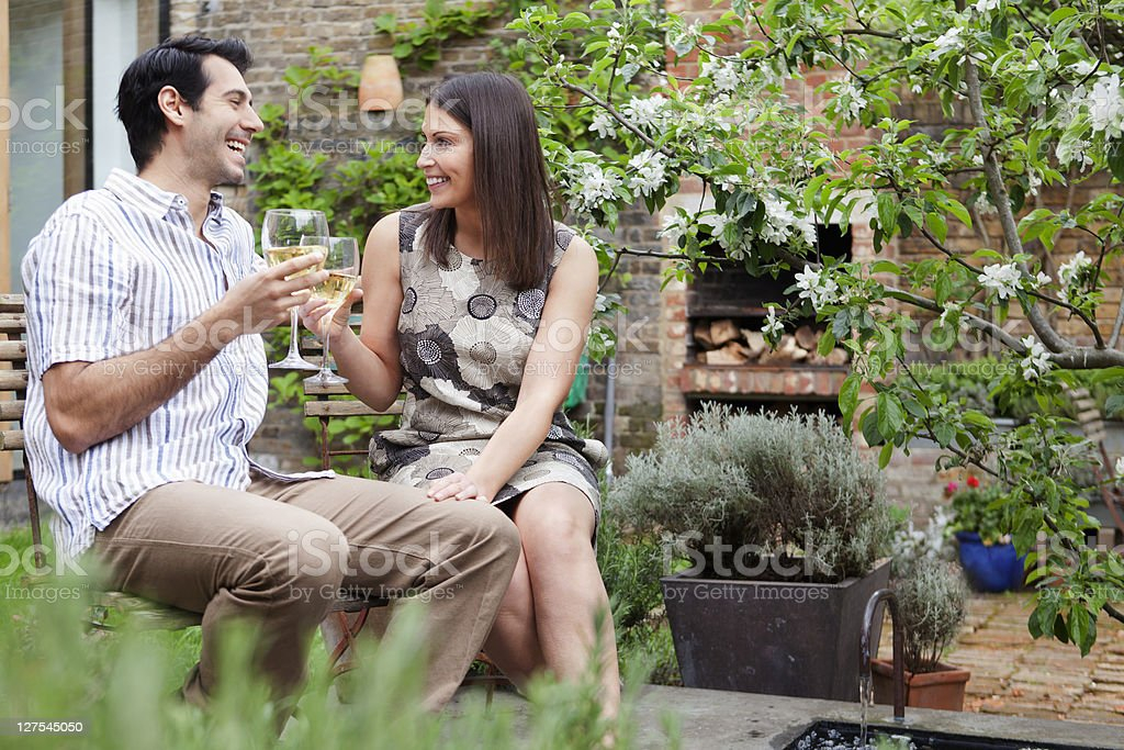 Couple drinking wine together outdoors stock photo