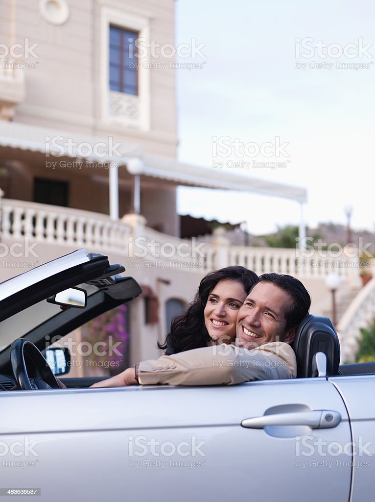 Couple driving convertible stock photo