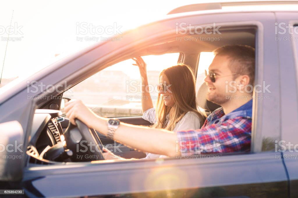 Couple driving in car stock photo