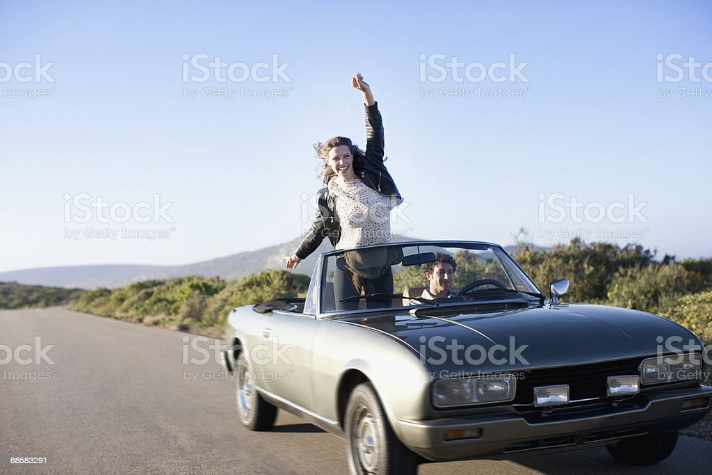 Couple driving in convertible royalty-free stock photo