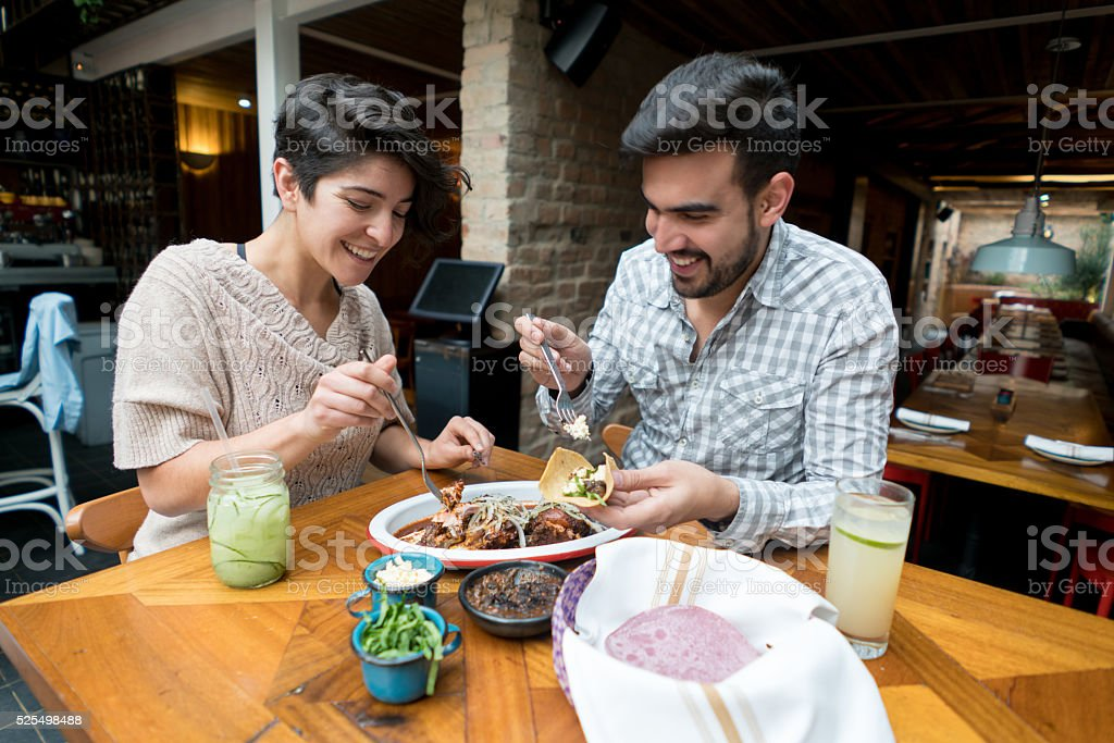 Couple eating at a Mexican restaurant stock photo