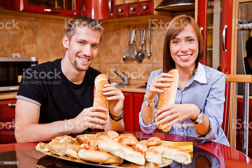 Couple eating bakery products royalty-free stock photo