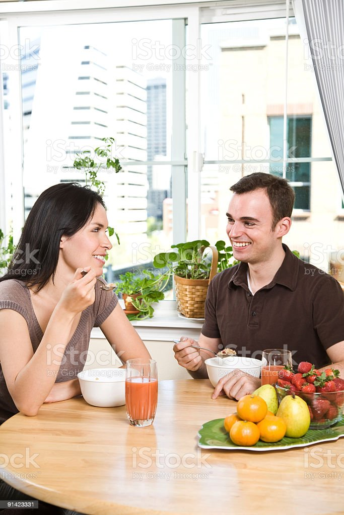 Couple eating breakfast royalty-free stock photo