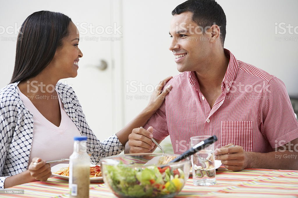 Couple Eating Meal Together At Home royalty-free stock photo