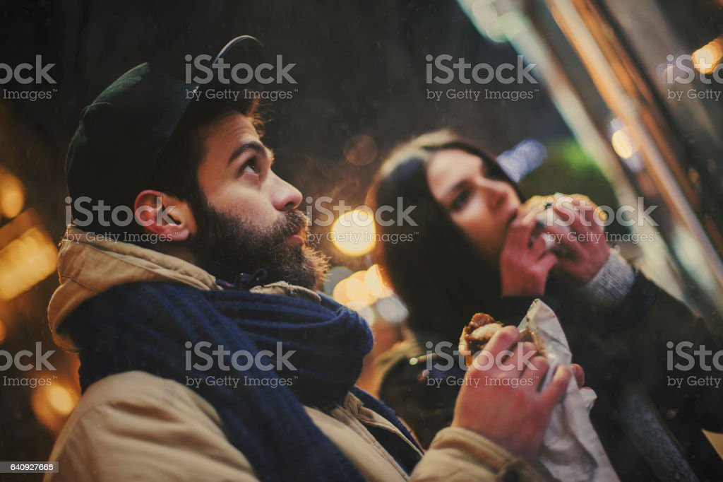 Couple eating on the street stock photo