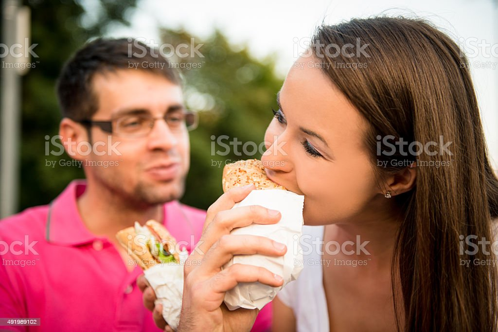 Couple eating outdoor stock photo