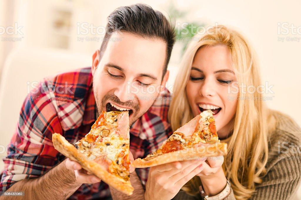 Couple eating pizza stock photo