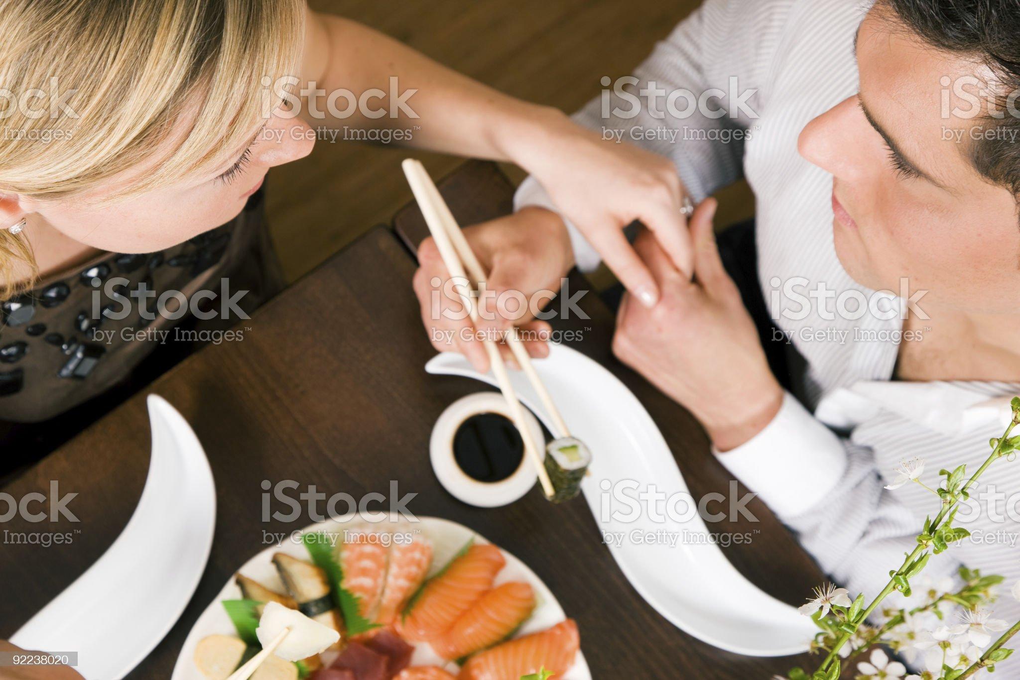 Couple eating Sushi royalty-free stock photo