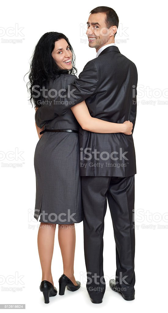 Couple embrace backside, rear view, studio portrait on white. stock photo